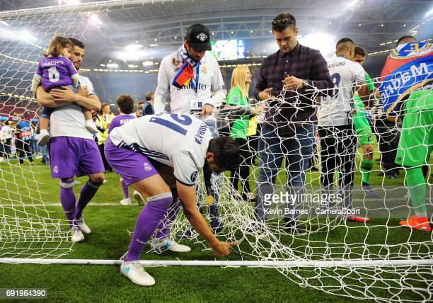 Alvaro Morata of Real Madrid cuts down a section of the goal netting during the UEFA Champions League Final match between Juventus and Real Madrid at...