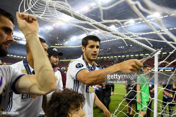 Alvaro Morata of Real Madrid cuts the net after the UEFA Champions League Final between Juventus and Real Madrid at National Stadium of Wales on June...