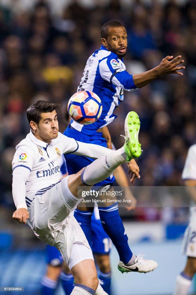 Alvaro Morata of Real Madrid duels for the ball with Sidnei Rechel Da Silva of RC Deportivo La Coruna during the La Liga match between RC Deportivo La Coruna and Real Madrid at Riazor Stadium on April 26, 2017 in La Coruna, Spain.