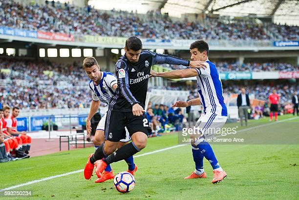 Alvaro Morata of Real Madrid duels for the ball with Yuri Berchiche of Real Sociedad during the La Liga match between Real Sociedad de Futbol and...