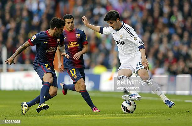 Alvaro Morata of Real Madrid is challenged by Daniel Alves and Pedro Rodriguez of Barcelona during the La Liga match between Real Madrid and FC...