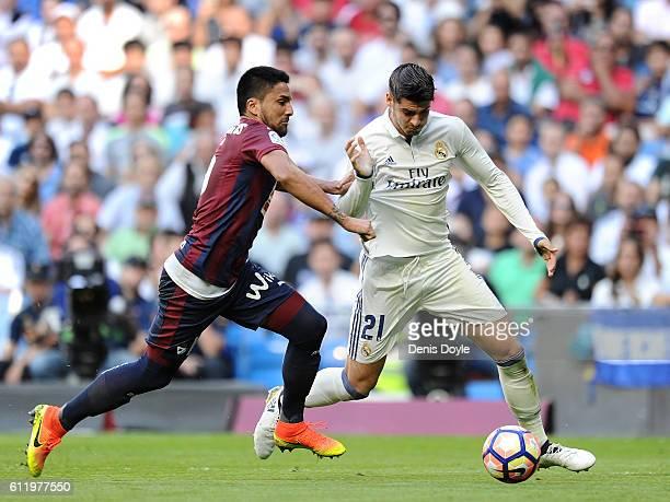 Alvaro Morata of Real Madrid is challenged by Mauro Dos Santo of SD Eibar during the La Liga Match between Real Madrid CF and SD Eibar at estadio...
