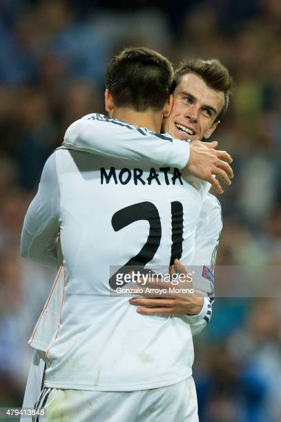Alvaro Morata of Real Madrid is congratulated by teammate Gareth Bale after scoring his team's third goal during the UEFA Champions League Round of...