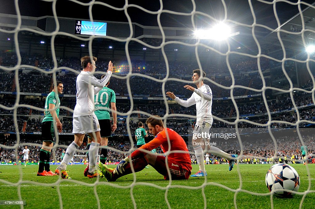 Alvaro Morata (R) of Real Madrid is congratulated by teammate Gareth Bale (L) after scoring his team's third goal, whilst dejected goalkeeper Ralf Fahrmann of Schalke reacts during the UEFA Champions League Round of 16, second leg match between Real Madrid and FC Schalke 04 at Estadio Santiago Bernabeu on March 18, 2014 in Madrid, Spain.
