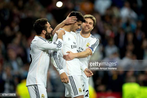 Alvaro Morata of Real Madrid is congratulated by teammates after scoring his team's third goal during the UEFA Champions League Round of 16 second...