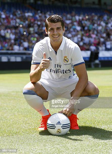 Alvaro Morata of Real Madrid poses during his official presentation at Estadio Santiago Bernabeu on August 15 2016 in Madrid Spain