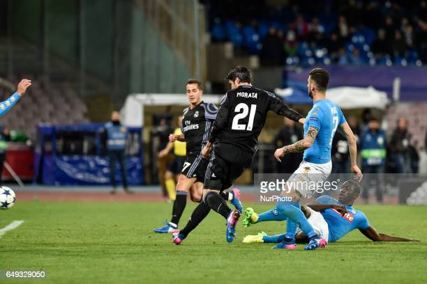 Alvaro Morata of Real Madrid scores his side third goal during the UEFA Champions League Round of 16 game 2 match between Napoli and Real Madrid at...