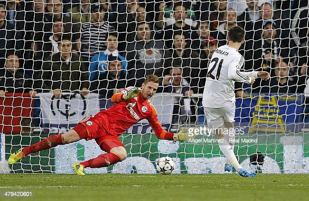 Alvaro Morata of Real Madrid scores his team's third goal past goalkeeper Ralf Fahrmann of FC Schalke 04 during the UEFA Champions League Round of 16...