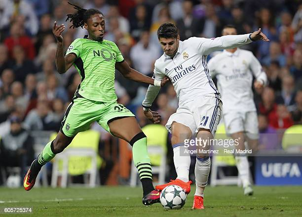 Alvaro Morata of Real Madrid shoots on goal under pressure from Ruben Semedo of Sporting Clube de Portugal during the UEFA Champions League Group F...