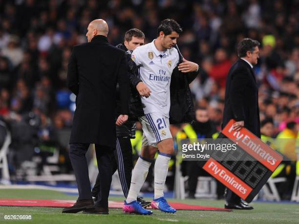 Alvaro Morata of Real Madrid walks past his head coach Zinedine Zidane after coming off during the La Liga match between Real Madrid CF and Real...