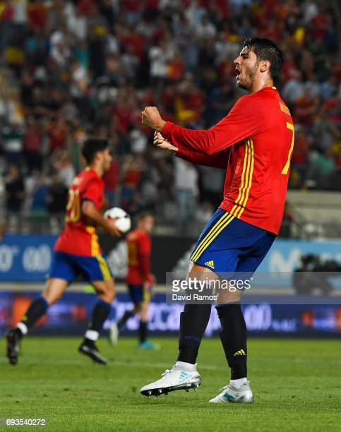 Alvaro Morata of Spain celebrates after scoring his team's second goal during a friendly match between Spain and Colombia at La Nueva Condomina...