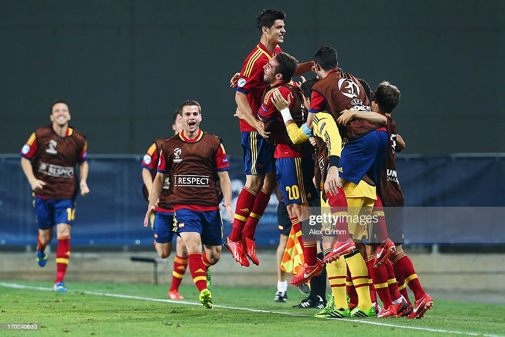 Alvaro Morata (top) of Spain celebrates his team's winning goal with team mates during the UEFA European U21 Champiosnship Group B match between Germany and Spain at Netanya Stadium on June 9, 2013 in Netanya, Israel.