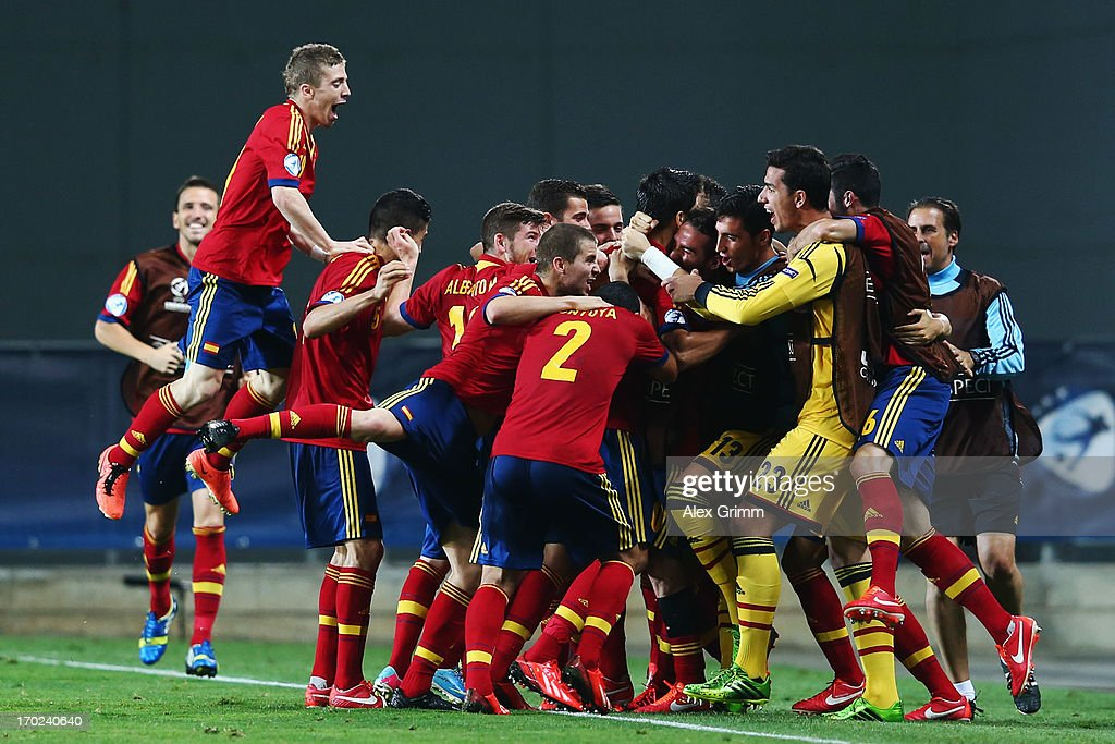 Alvaro Morata (C) of Spain celebrates his team's winning goal with team mates during the UEFA European U21 Champiosnship Group B match between Germany and Spain at Netanya Stadium on June 9, 2013 in Netanya, Israel.