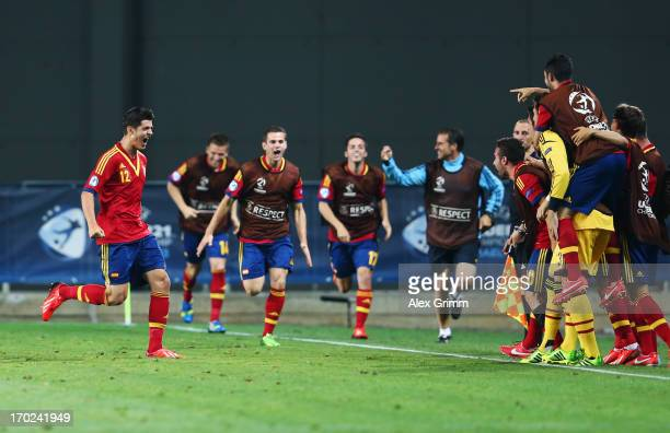 Alvaro Morata of Spain celebrates his team's winning goal with team mates during the UEFA European U21 Champiosnship Group B match between Germany...