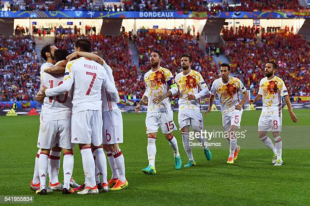 Alvaro Morata of Spain celebrates scoring his team's first goal with his team mates during the UEFA EURO 2016 Group D match between Croatia and Spain...