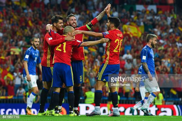 Alvaro Morata of Spain celebrates with his team mates David Silva Sergio Ramos and Marco Asensio of Spain after scoring his team's third goal during...
