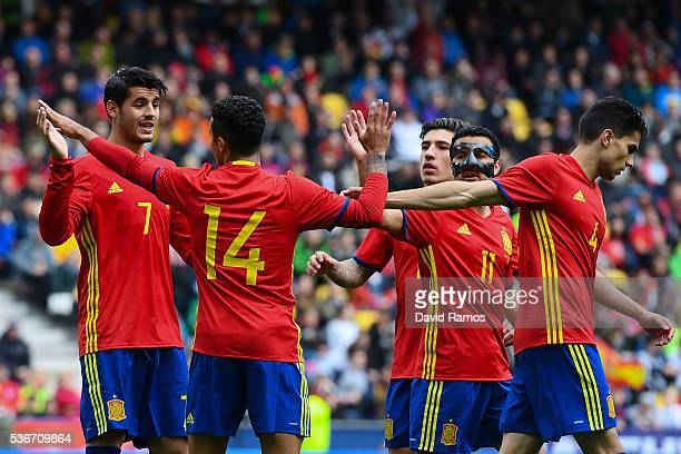 Alvaro Morata of Spain celebrates with his teammates after scoring his team's fourth goal during an international friendly match between Spain and...