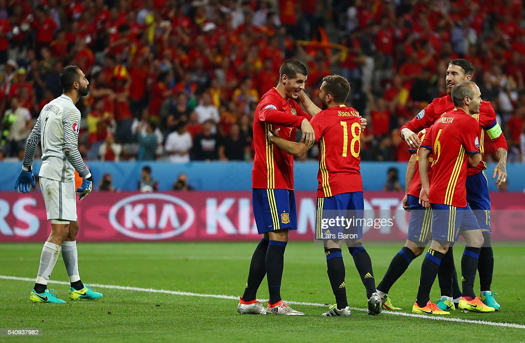Alvaro Morata of Spain celebrates with Jordi Alba after scoring his second and his sides third goal during the UEFA EURO 2016 Group D match between Spain and Turkey at Allianz Riviera Stadium on June 17, 2016 in Nice, France.
