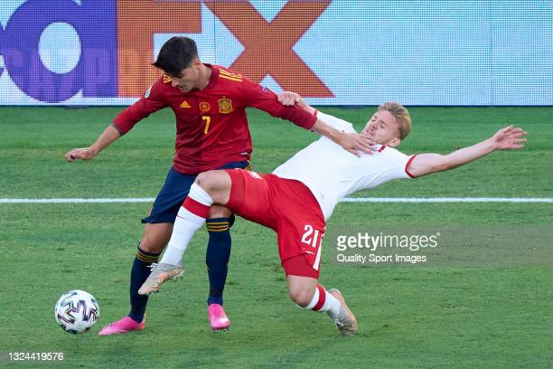 Alvaro Morata of Spain competes for the ball with Kamil Jozwiak of Poland during the UEFA Euro 2020 Championship Group E match between Spain and...