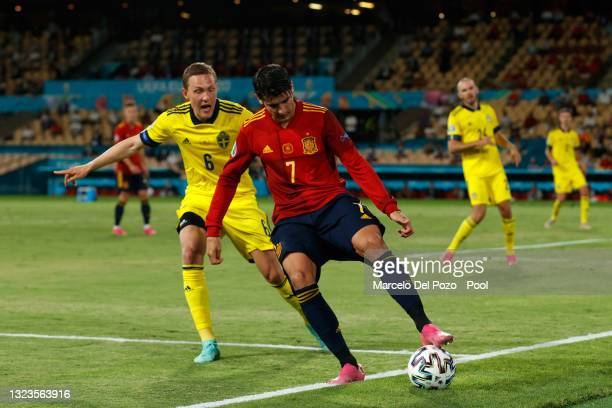 Alvaro Morata of Spain fails to keep the ball in play as he is closed down by Ludwig Augustinsson of Sweden during the UEFA Euro 2020 Championship...