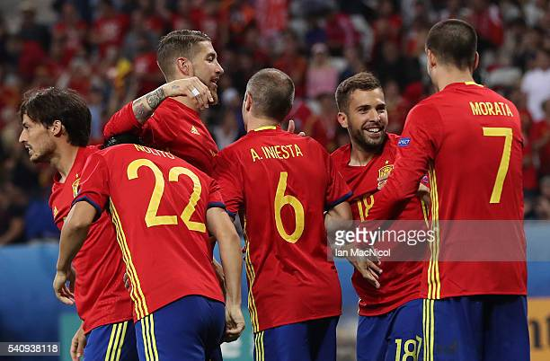 Alvaro Morata of Spain is congratulated by team mates after he scores his teams third goal during the UEFA EURO 2016 Group D match between Spain and...