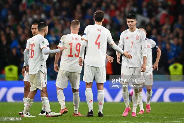 Alvaro Morata of Spain is consoled by Dani Olmo and Pau Torres of Spain after he misses their side's fourth penalty in the penalty shoot out during...