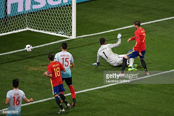 Alvaro Morata of Spain scores his sides third and his second goal past Volkan Babacan of Turkey during the UEFA EURO 2016 Group D match between Spain...