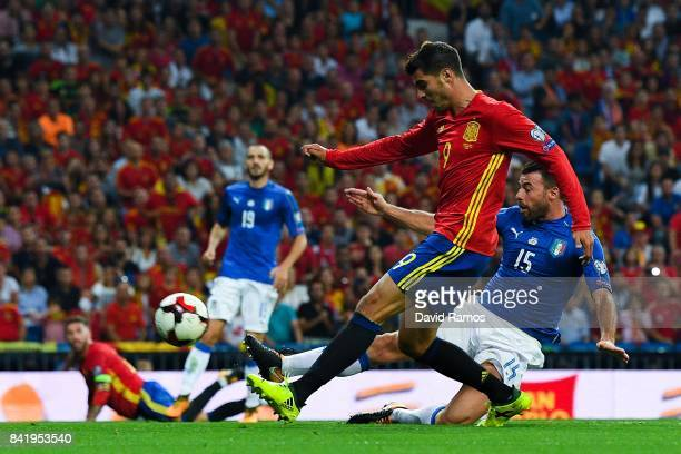 Alvaro Morata of Spain scores his team's third goal during the FIFA 2018 World Cup Qualifier between Spain and Italy at Estadio Santiago Bernabeu on...