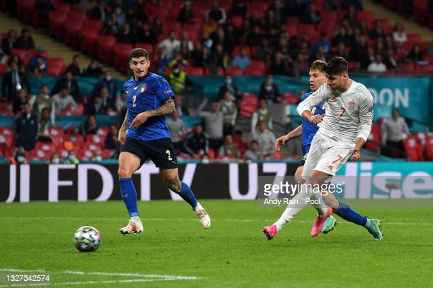 Alvaro Morata of Spain scores their team's first goal during the UEFA Euro 2020 Championship Semi-final match between Italy and Spain at Wembley...