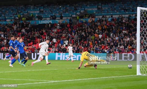 Alvaro Morata of Spain scores their team's first goal past Gianluigi Donnarumma of Italy during the UEFA Euro 2020 Championship Semi-final match...
