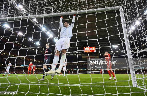 Alvaro Morata of Spain swings on the crossbar during the International Friendly match between Wales and Spain on October 11 2018 in Cardiff United...