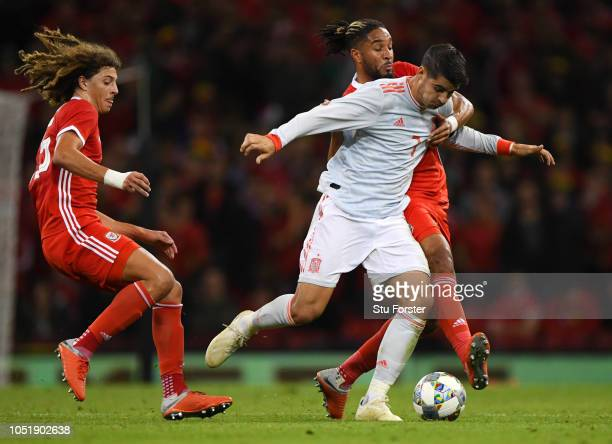 Alvaro Morata of Spain takes on Ashley Williams and Ethan Ampadu of Wales during the International Friendly match between Wales and Spain on October...