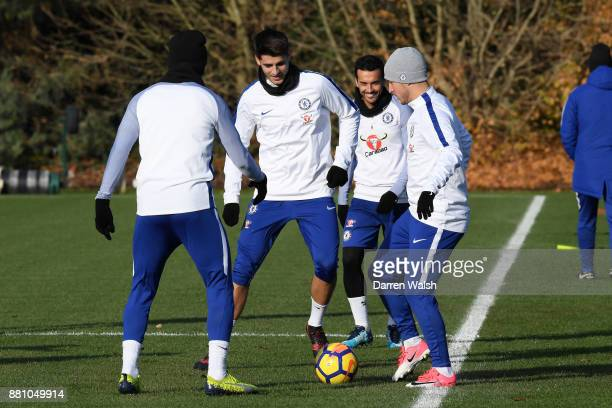 Alvaro Morata Pedro and Eden Hazard of Chelsea during a training session at Chelsea Training Ground on November 28 2017 in Cobham England