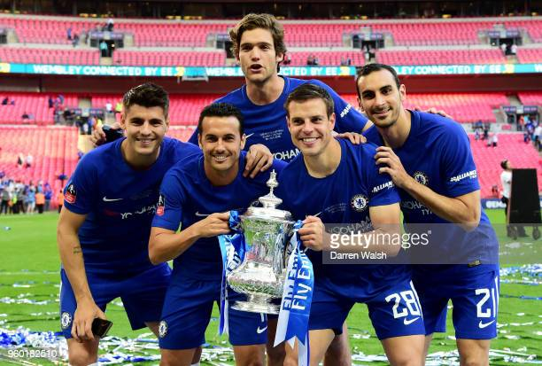 Alvaro Morata Pedro Marcos Alonso Cesar Azpilicueta and Davide Zappacosta of Chelsea pose with the Emirates FA Cup Trophy following their sides...