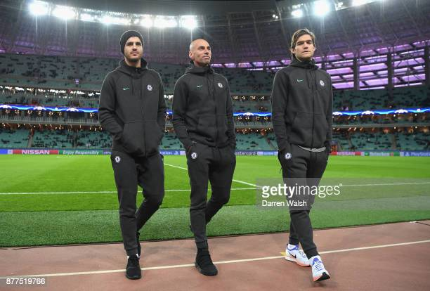 Alvaro Morata Willy Caballero and Marcos Alonso of Chelsea walk back to the dressing room after inspecting the pitch prior to the UEFA Champions...