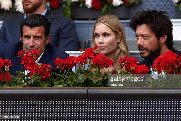 Alvaro Morte Helen Svedin and Luis Figo attend day nine of the Mutua Madrid Open at La Caja Magica on May 13 2018 in Madrid Spain