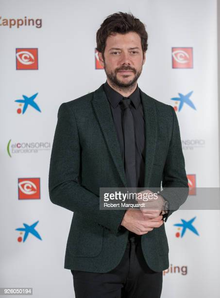 Alvaro Morte poses during a photocall for 'Zapping Awards 2018' held at the CaixaForum on March 1 2018 in Barcelona Spain