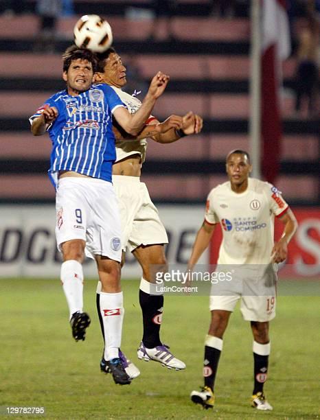 Alvaro Navarro of Godoy Cruz and Carlos Galván of Universitario during a match between Godoy Cruz of Argentina and Universitario of Peru as part of...
