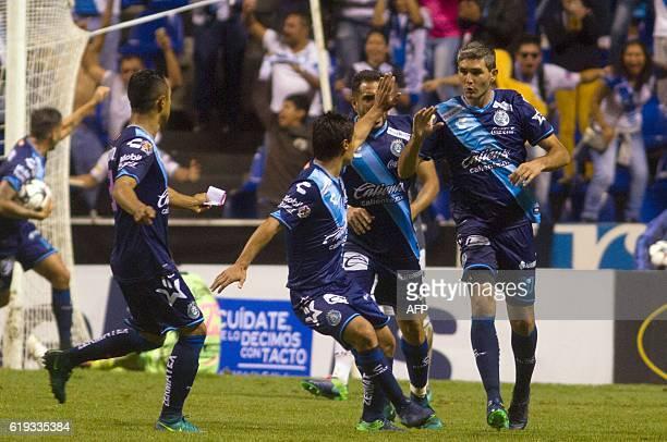 Alvaro Navarro of Puebla celebrates his goal against Leon during their Mexican Apertura 2016 Tournament football match at the Cuauhtemoc stadium on...