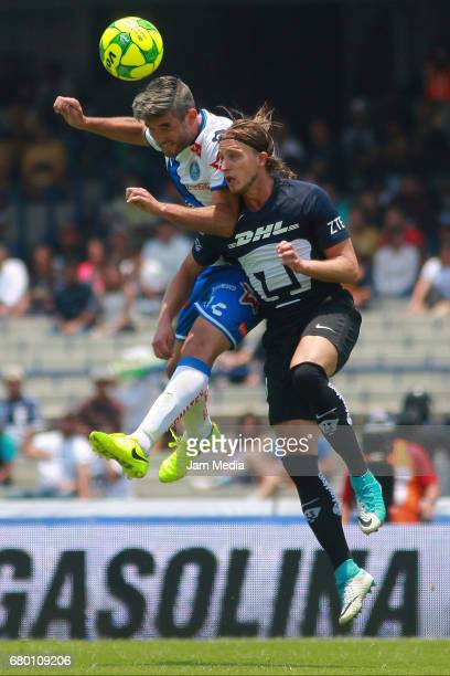 Alvaro Navarro of Puebla fights for the ball with Jose Garcia of Pumas during the 17th round match between Pumas UNAM and Puebla as part of the...