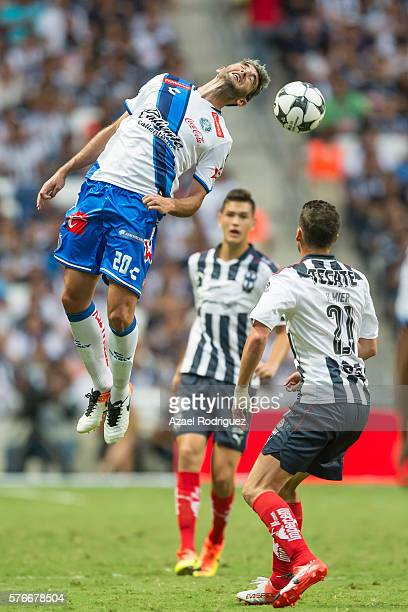 Alvaro Navarro of Puebla heads the ball during the 1st round match between Monterrey and Puebla as part of the Torneo Apertura 2016 Liga MX at BBVA...