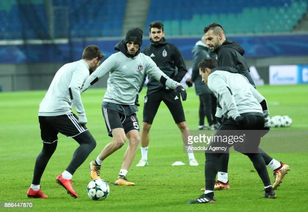 Alvaro Negredo and Adriano Correia Claro of Besiktas attend a training session ahead of the UEFA Champions League group G match between RB Leipzig...