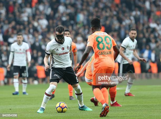 Alvaro Negredo of Besiktas in action against Gassam of Aytemiz Alanyaspor during a Turkish Super Lig week 27 soccer match between Besiktas and...