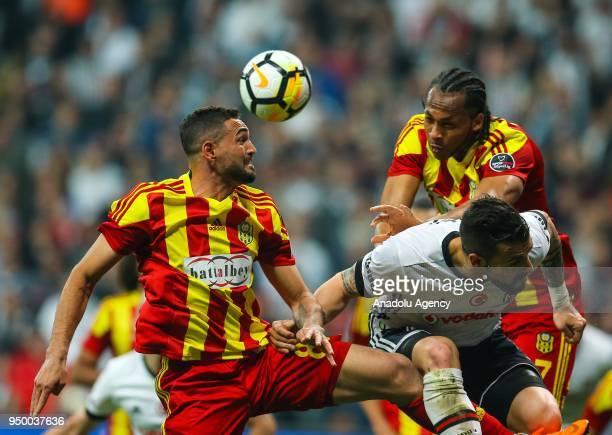 Alvaro Negredo of Besiktas in action against Gilberto Olivera Souza and Issiar Dia of Evkur Yeni Malatyaspor during Turkish Super Lig soccer match...