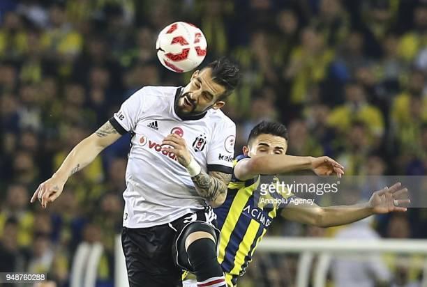 Alvaro Negredo of Besiktas in action against Hasan Ali Kaldirim of Fenerbahce during Ziraat Turkish Cup Semi Final second leg soccer match between...