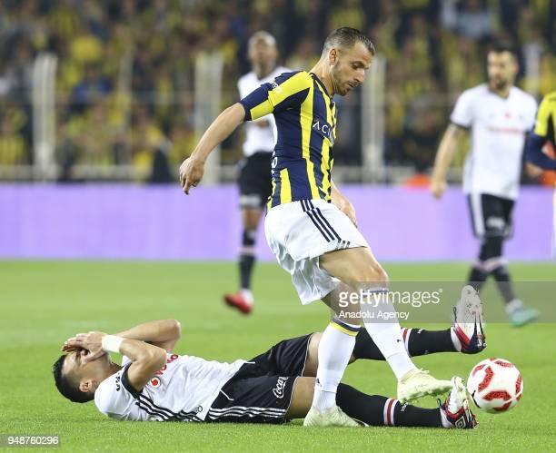 Alvaro Negredo of Besiktas in action against Roberto Soldado of Fenerbahce during Ziraat Turkish Cup Semi Final second leg soccer match between...