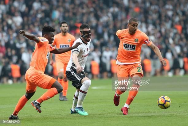 Alvaro Negredo of Besiktas in action against Welinton Souza of Aytemiz Alanyaspor during a Turkish Super Lig week 27 soccer match between Besiktas...