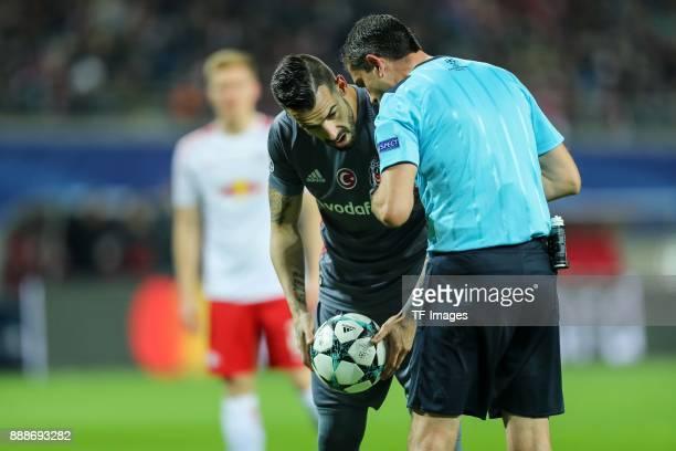 Alvaro Negredo of Besiktas speak with Referee Viktor Kassai during the UEFA Champions League group G soccer match between RB Leipzig and Besiktas at...