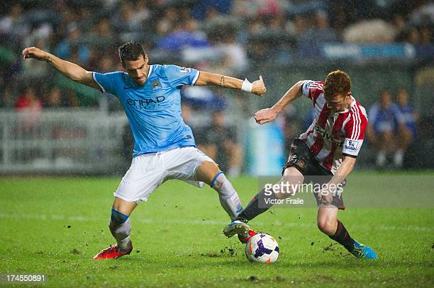 Alvaro Negredo of Machester City and Jack Colback of Sunderland compete for the ball during the Barclays Asia Trophy Final match between Manchester...