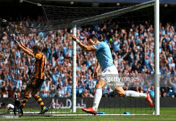 Alvaro Negredo of Manchester City celebrates after scoring the opening goal during the Barclays Premier League match between Manchester City and Hull...